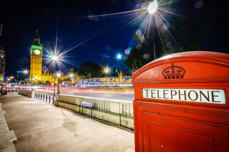 Red Telephone Booth and Big Ben at night royalty free stock photography
