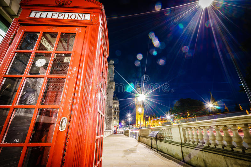 Red Telephone Booth and Big Ben at night stock images