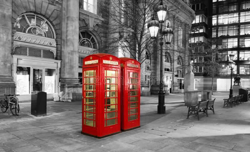 Red telephone booth in the City of London. By night royalty free stock photo