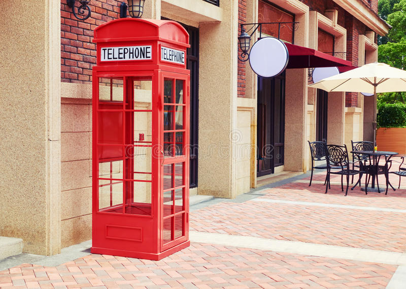 London red telephone booth box. Empty London red telephone booth. Red telephone box in patio royalty free stock photo
