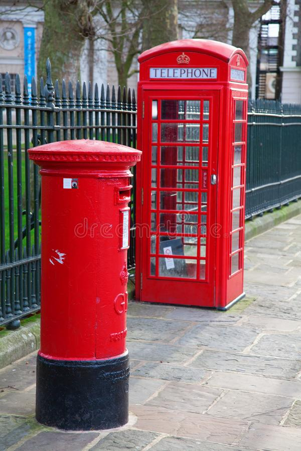 Red telephone booth in London. Famous red telephone booth in London, UK royalty free stock photo