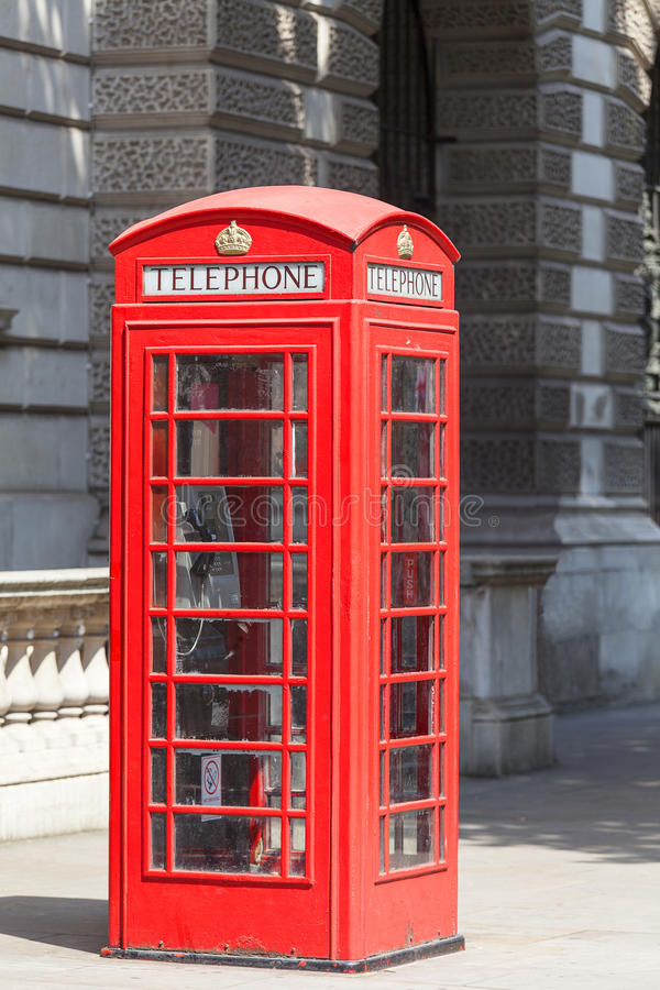 Red telephone booth on the street in the city, London, United Kingdom royalty free stock images