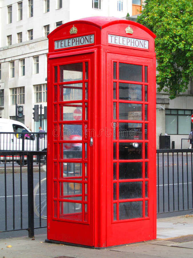 Red Telephone Box. On a busy central London road (near Blackfriars Bridge royalty free stock photos