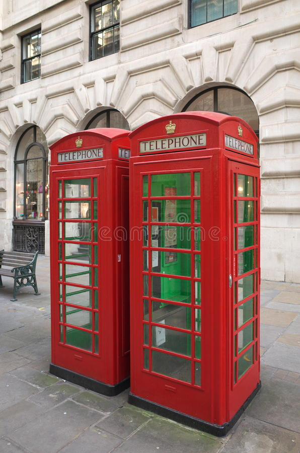 Red Telephone Boxes - London. London, England - December 28, 2015: Two traditional red telephone boxes in Central London, England. The original kiosks were first stock photography