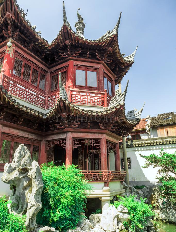 Red temple, traditional chinese buildings and rocks at Yu Gardens, Shanghai, China.  stock photos