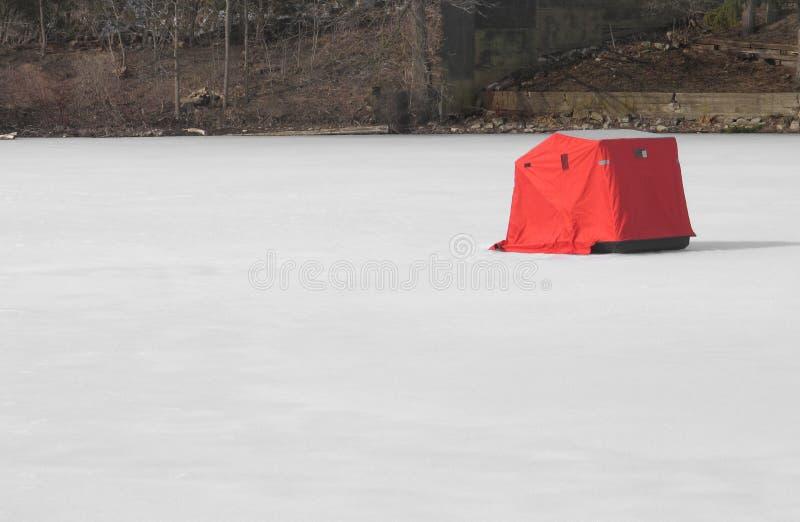 Ice fishing tent on frozen lake stock photo
