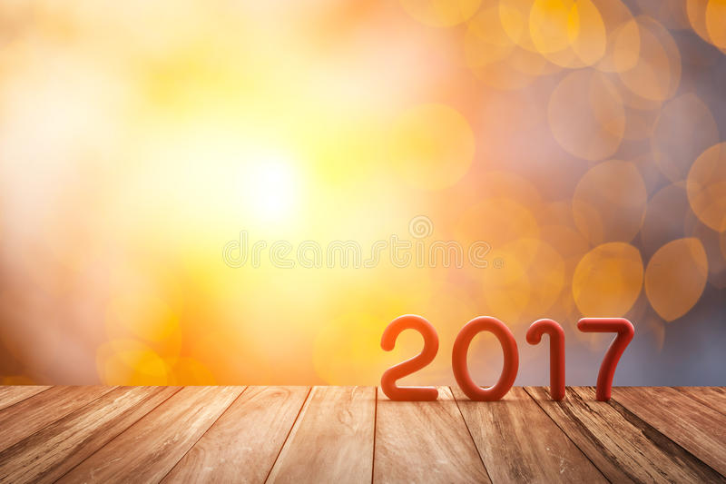 Red 2017 Text on Old Wood Floor on Abstract blur bokeh and flare light. For Happy new year Background stock illustration