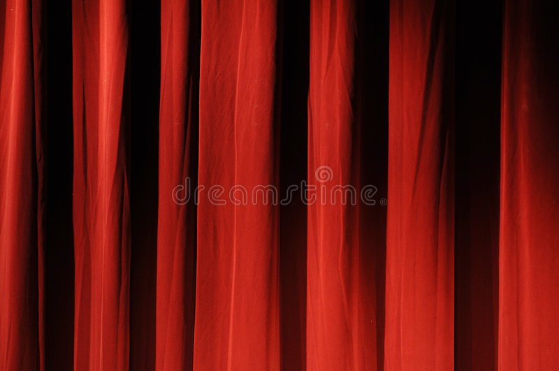 Red theater curtain. A view of a thick, rich, red theater curtain royalty free stock images
