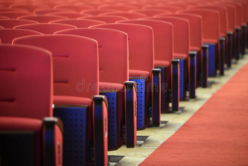 Red Theatre. Red Chairs in a theatre. Perfect for inserting a person into the image to make them appear as though they were in the theatre. Also useful for stock photo
