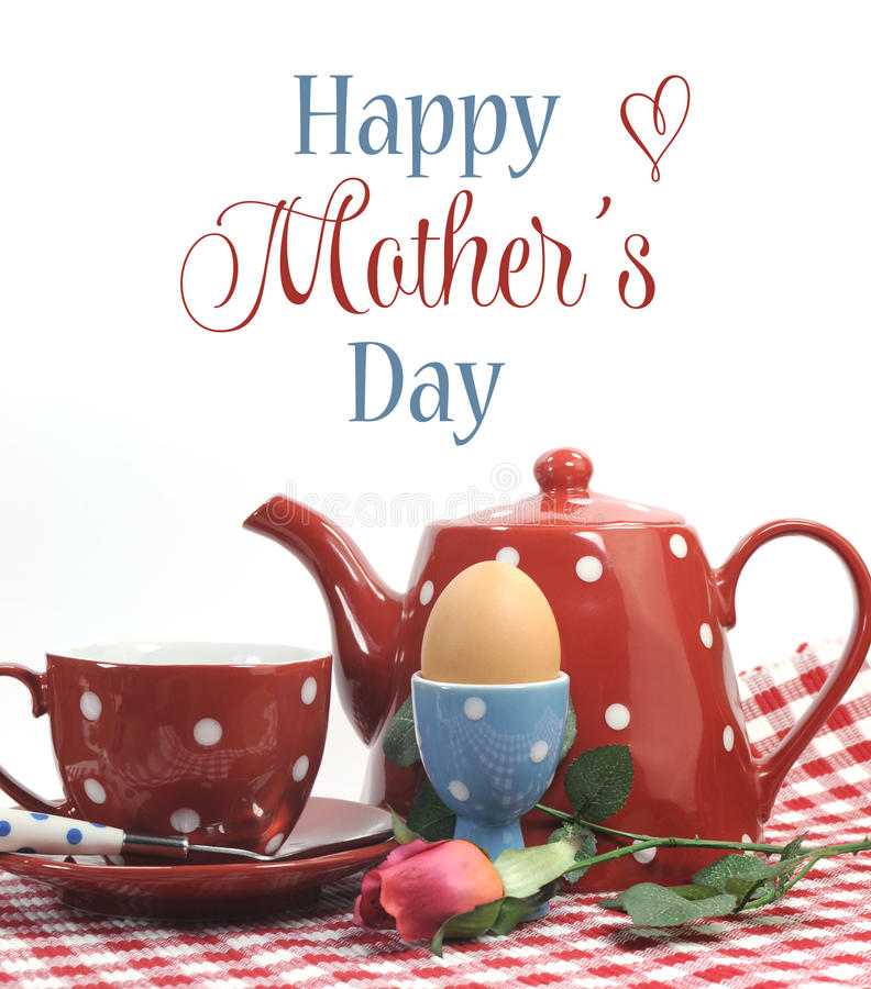 Red theme Happy Mothers Day breakfast with sample text. Red theme Happy Mothers Day breakfast in bed with tea cup, tea pot and egg in red and blue polka dot stock photography