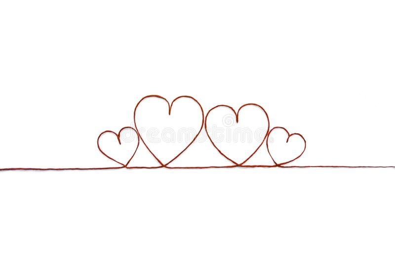 Red thread and heart isolated on white background stock images