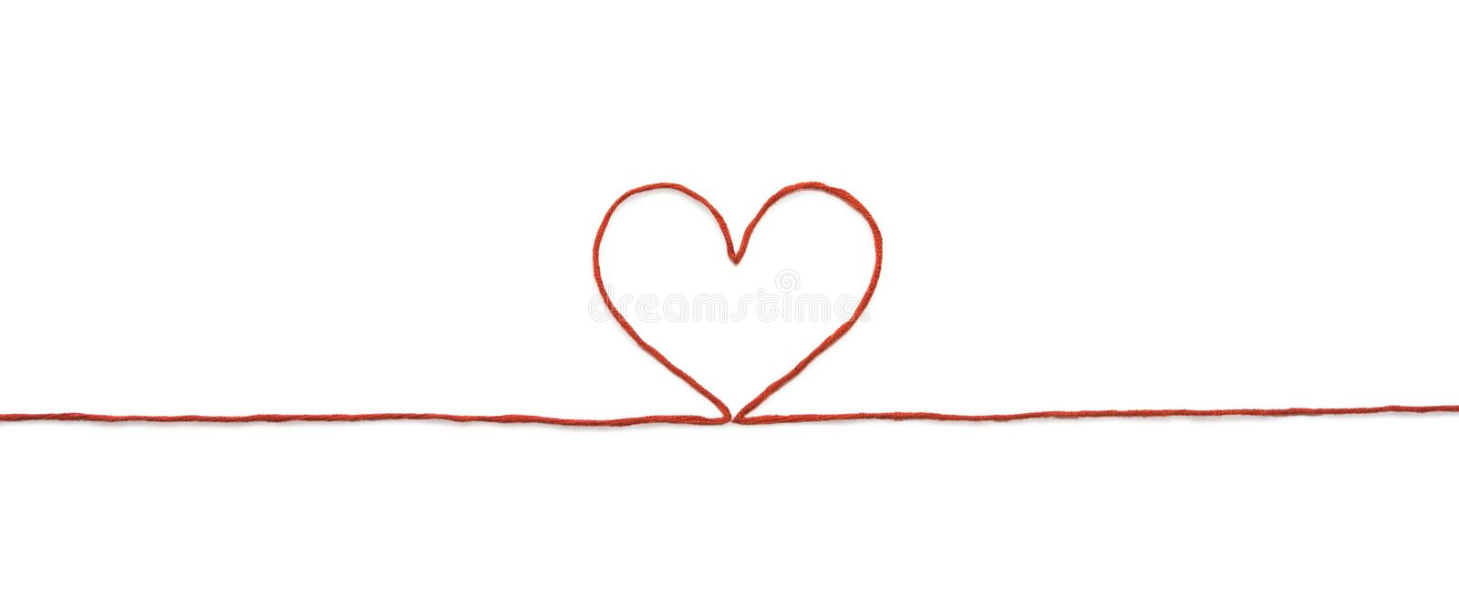 Red thread and heart isolated on white background stock photos