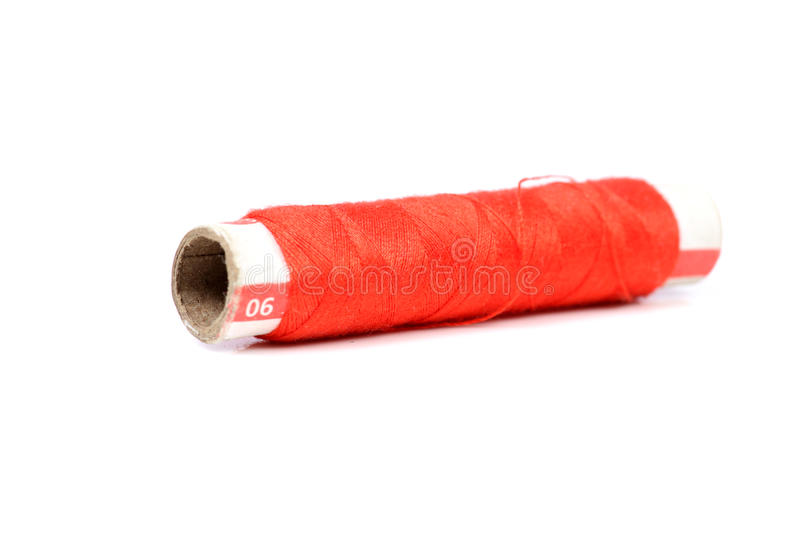 Red thread spindle. Beautiful shot of red thread spindle on white background stock photos