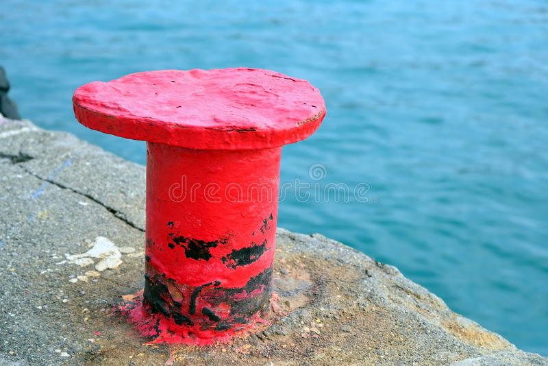 Red thumb on the stone pier royalty free stock image