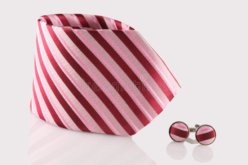Red tie with cuff links. On white background stock images