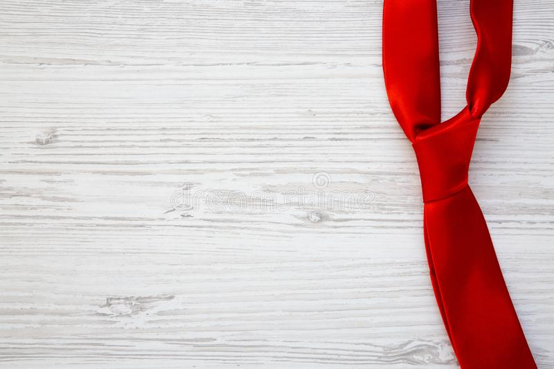 Red tie on white wooden background. Happy Father`s Day. Copy spa royalty free stock image