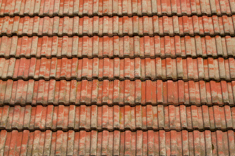 Red tile roof. Faded corrugated red tile roof in the sun royalty free stock image