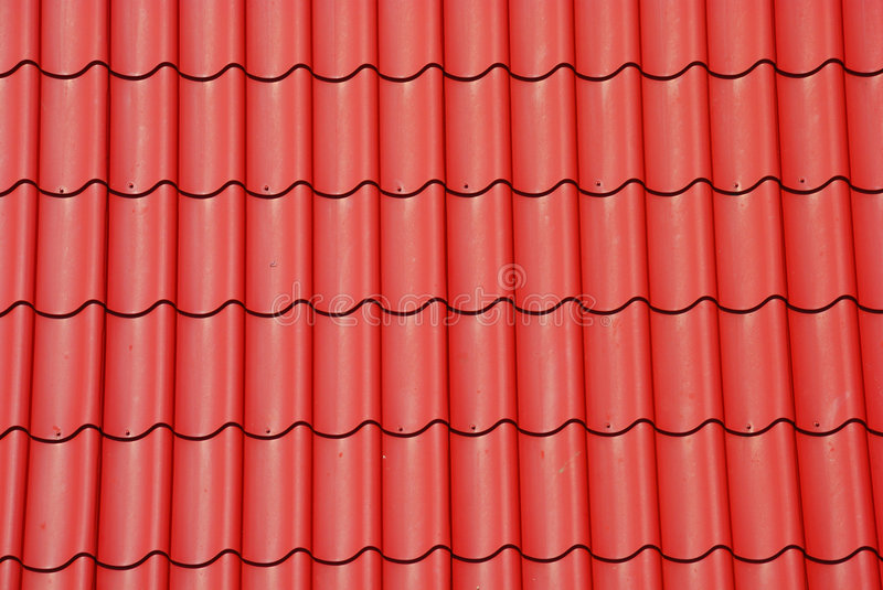 Red tile on the roof. As a background royalty free stock image