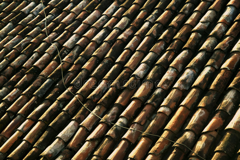 Red Tile Roof. With Electrical Line Running Across it in Central America royalty free stock photos