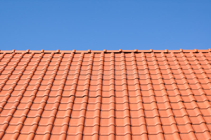 Red tile roof. Red tile roof against the blue sky stock images