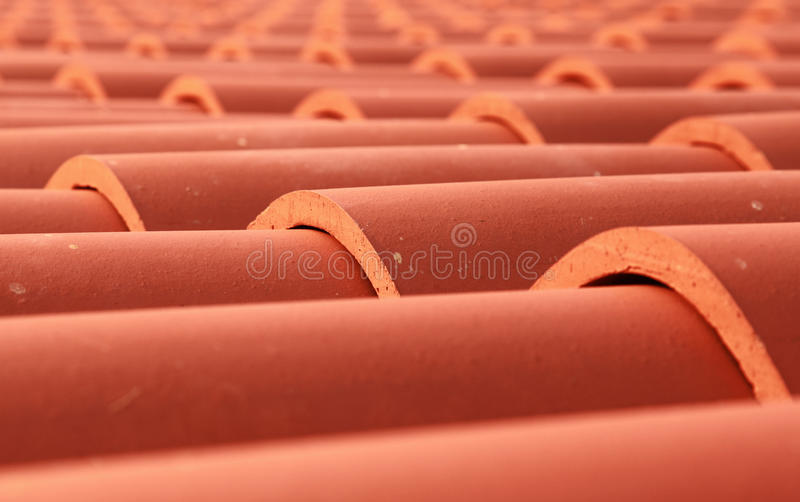 Red tile roof closeup photo. With selective focus stock photography