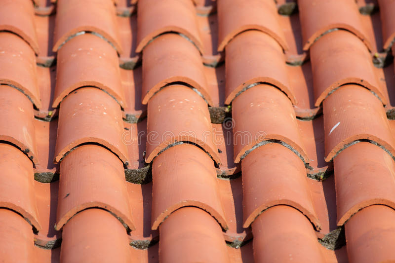 Red tile roof. Construction detail of a red tile roof stock image