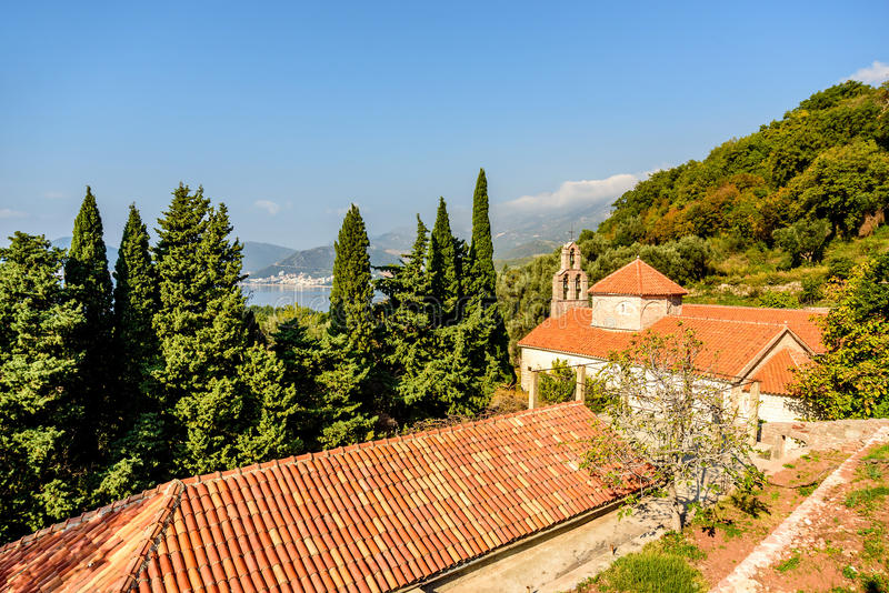 The red tile roof of the Holy Trinity Church Praskvica Monaster. Y, Montenegro stock photo