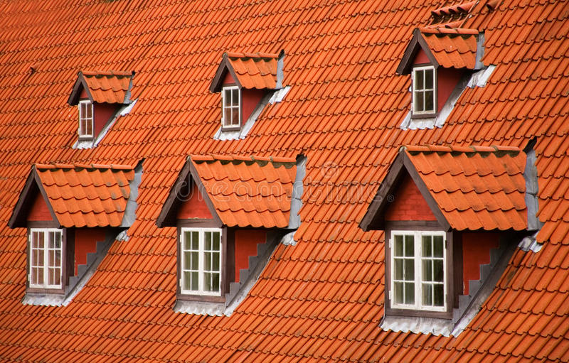 Red tile roof and mansards. Red tile roof and garrets royalty free stock image