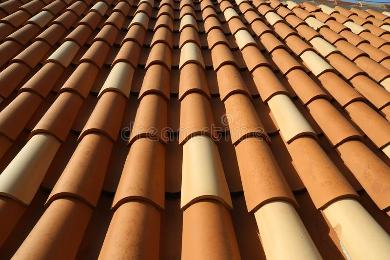 Red tile roof. Roof tiles on the roof royalty free stock image