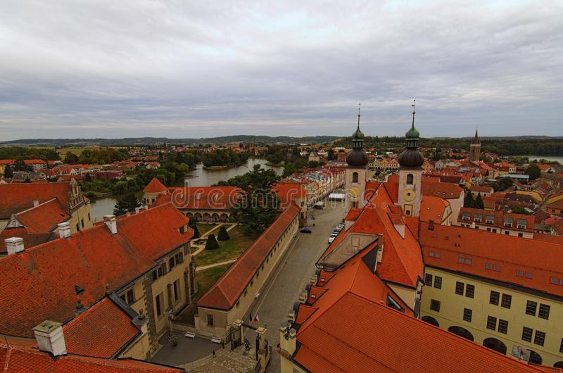 Red tile roofs in medieval city. Aerial view of Telc with main square and towers of the Church of the Holy Name of Jesus. A UNESCO World Hege Site. Telc, Czech royalty free stock images