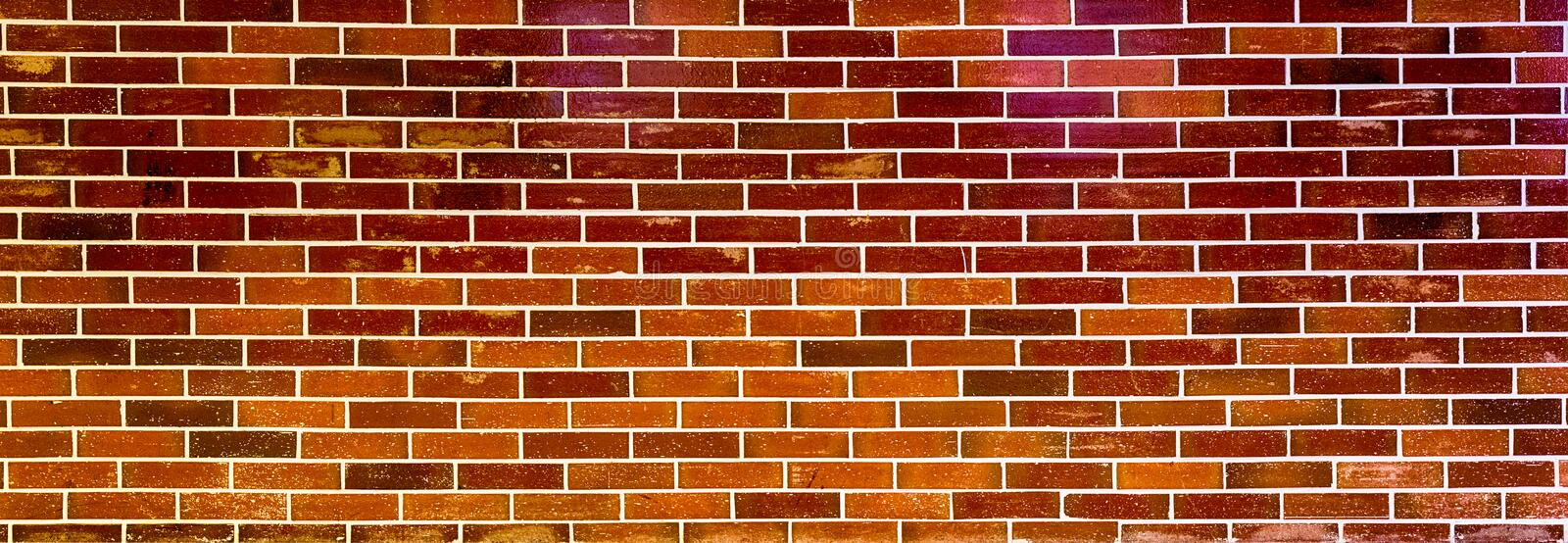 The red tile wall background. The red tile wall can be used as the wall background of personality style stock photos