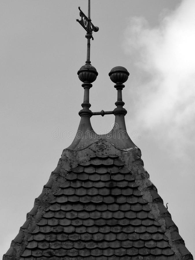 Medieval tower peak with tiled roof in black and white stock images