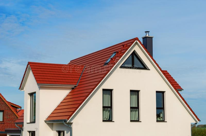 Red tiled roof of a modern house stock photos