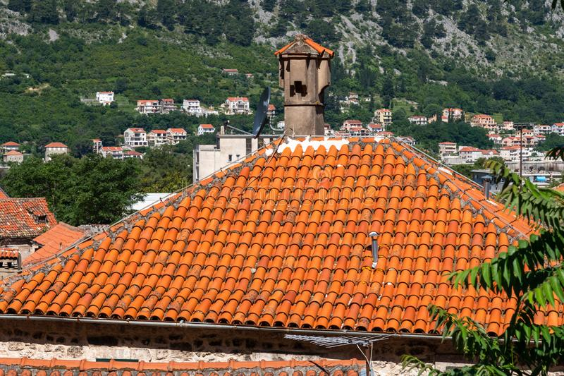 Red tiled roofs of old town houses in Kotor, Montenegro stock image
