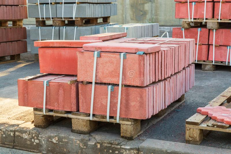 Tiles piled in pallets warehouse paving slabs the factory for its production. Red tiles piled in pallets warehouse paving slabs the factory for its production stock photography