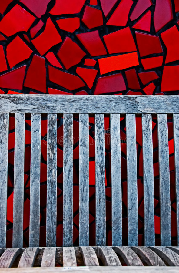 Red tiles and wood bench stock images