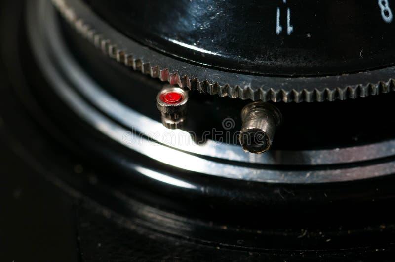 Red timer knob on old vintage camera. Red timer knob on old, vintage, dusty, Soviet photography camera stock images