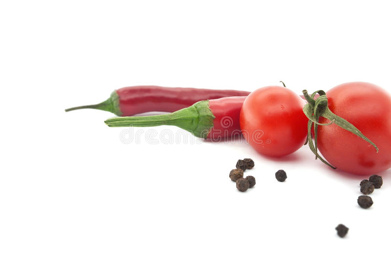 Red tomato and chili pepper. Vegetables for mexican food royalty free stock photos
