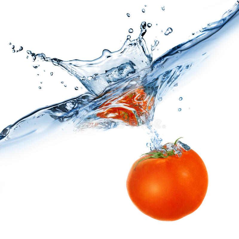 Red tomato dropped into water stock photo
