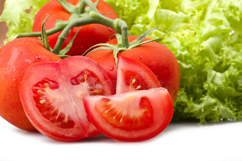 Red tomato and drops water stock photography
