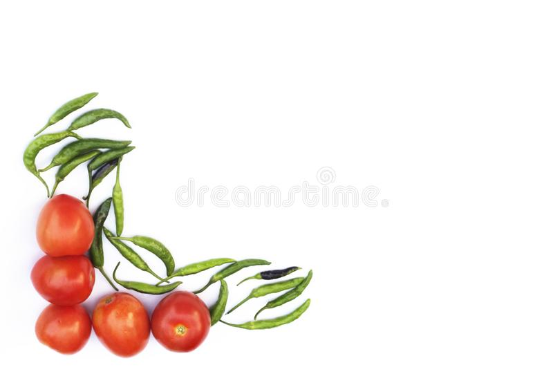 Red tomato and green chili pepper, essential vegetables for mexican food stock image