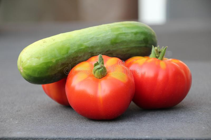 Red tomato with little green after harvesting them from kitchen garden in the Netherlands stock photos