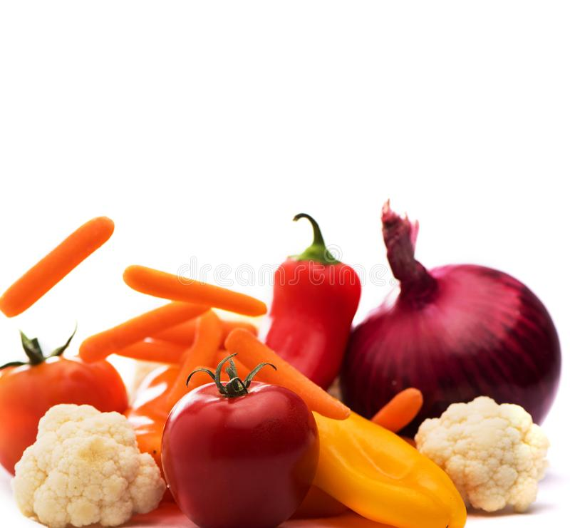 Red Tomato and Vegetables  for salad on white background. cauliflower, carrots, onion and peppers. Health Concept stock photo