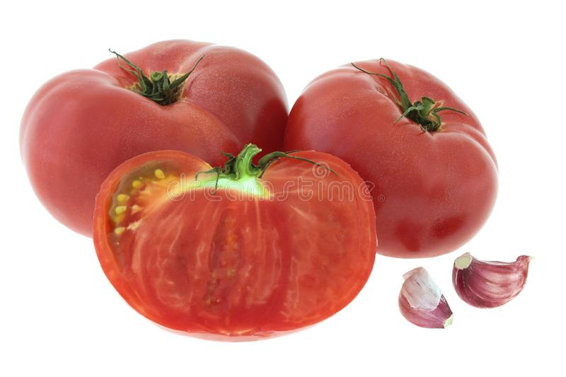 Red tomatoes with garlic isolated on white background royalty free stock image