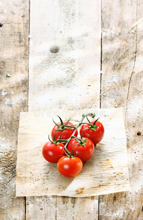 Red tomatoes in a grungy rustic kitchen