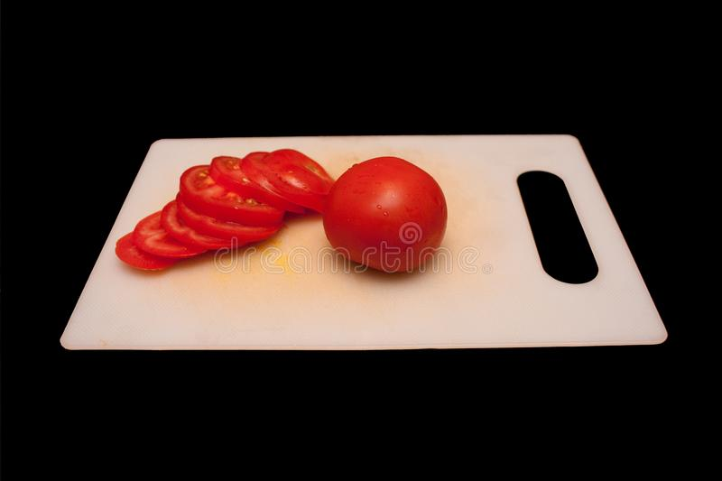 Tomatoes on a cutting board royalty free stock photography