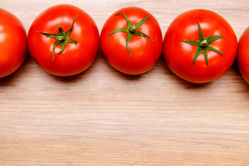 Download Red Tomatoes On Wooden Ground Stock Image - Image: 83703461