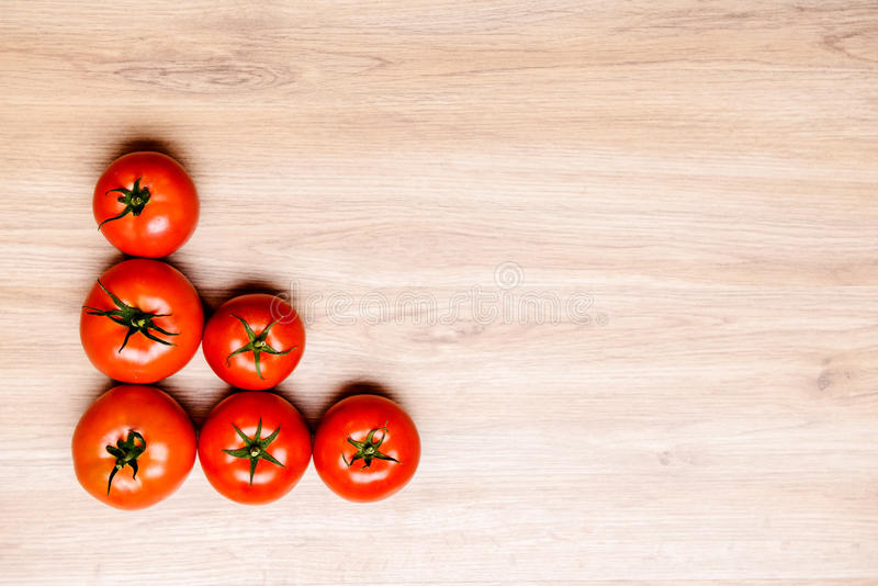 Download Red Tomatoes On Wooden Ground Stock Photo - Image: 83704729