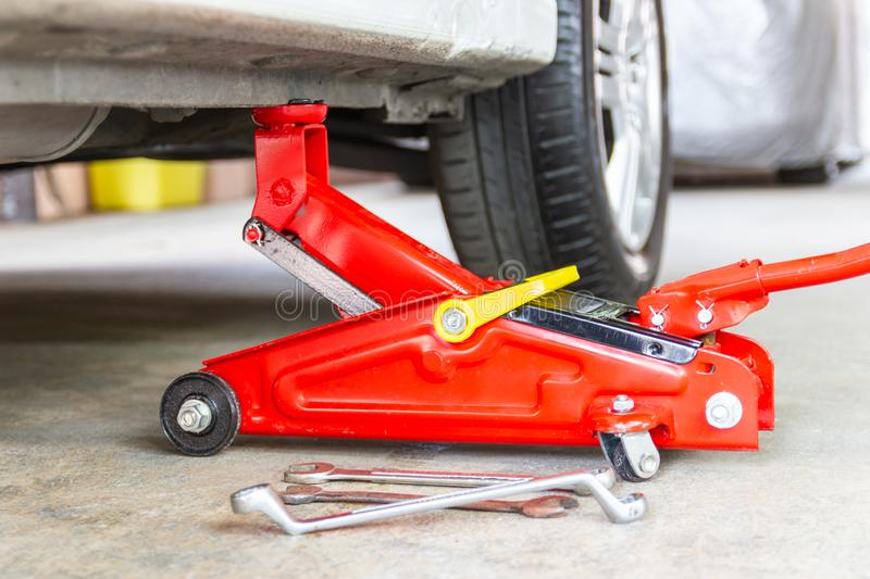 Red tool jack lift car for repair check Maintenance stock images