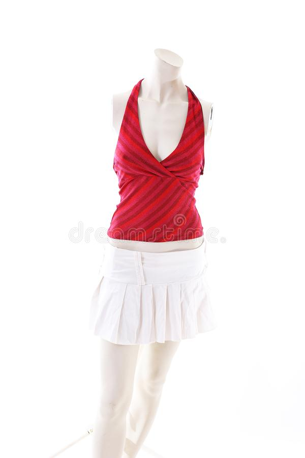 Red top and white mini skirt on mannequin full body shop display. Woman fashion styles, clothes on white studio background.  royalty free stock photos